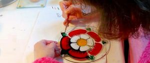 Hand painting Welsh Glass; Welsh art; Welsh artist at work; hand-crafted Welsh glass